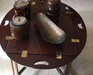 Round occasional table with antique humidors