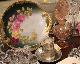Pretty antique plate with handles, knife rests, and tall perfume bottle