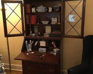 Secretary filled with fun decor items