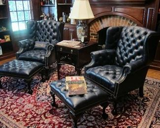 PAIR OF HANCOCK AND MOORE LEATHER CHAIRS AND OTTOMANS