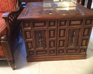 square side table with glass top and craved doors and top