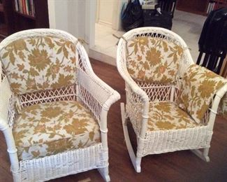 Two charming wicker rockers. One needs the foam cushion.   The fabric is there.