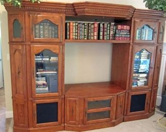 Entertainment unit with opening for large screen TV