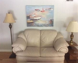 Leather love seat.  Beautiful boat scene oil painting  and brass lamps