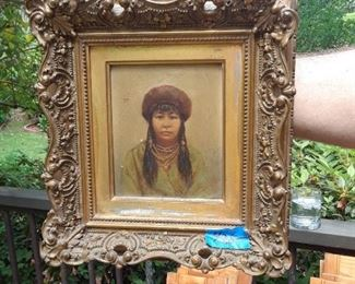 Oil on canvas in elaborate frame. Subject is Native American.