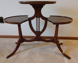 Tri-level harp table