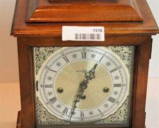 Howard Miller mantel clock; may need cleaning or repairs. Has key inside back panel. Comes with instructions.