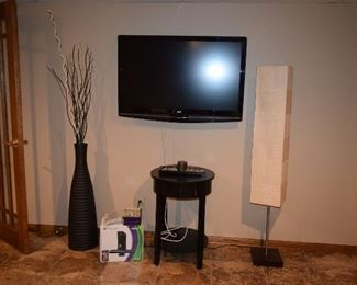Flat Screen TV, Floor Lamp, Accent Table, Vase W/Floral Accents