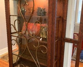 "Wood and glass lighted curio cabinet that measures 42"" x 72"" x 16 1/2""."