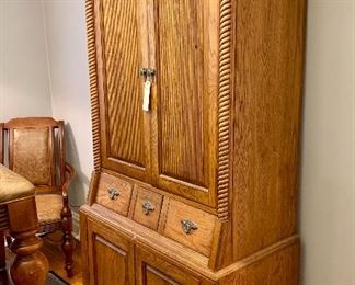 "Wooden secretary cabinet measuring 79"" x 39"" x 20""."
