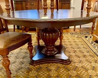 "Wooden round pedestal dining room table, 54"" diameter.  There is one, 24"" leaf.  Pads included."