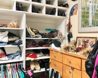 Large closet filled with designer clothing and shoes