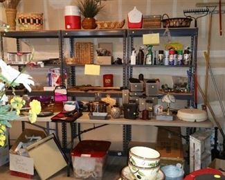 Three steel shelving units: $35.00 each. Nice wall decor, Rubbermaid, tupperware, pyrex, small appliances, Christmas tree, fertilizer spreader, small hand tools, yard tools, baskets and more