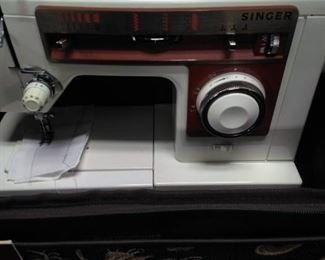 Singer Sewing Machine and Accessories    https://ctbids.com/#!/description/share/161862