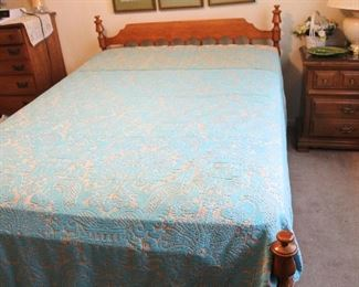 Full size bed with retro bedspread