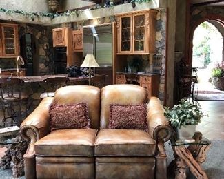 Reclining Leather Loveseat with  a Burl Wood and a Grapevine End Tables