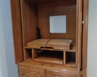 inside of armoire/entertainment center