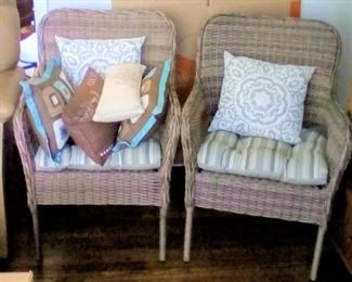 2 matching rattan chairs with matching seat covers