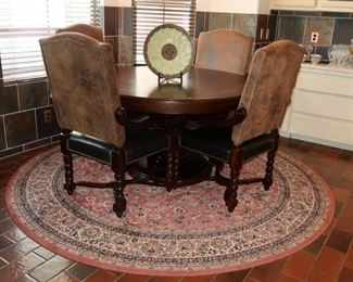 Round dining table with four chairs