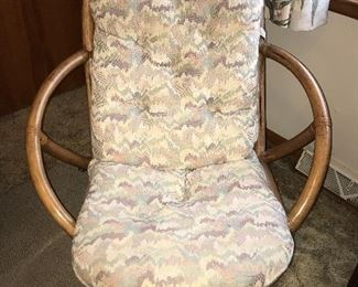 One of two matching rattan chairs.