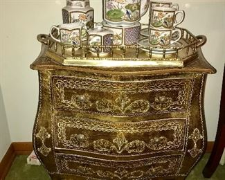 Gold leaf bombe chest with Made in Japan vintage tea set on brass gallery tray.