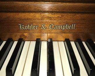 Beautiful Rohler and Campbell walnut spinet piano with bench--excellent condition.