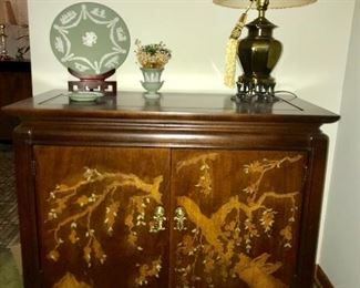 Lovely Asian-themed credenza with hand painted embellishment, lamp and Jasper ware by Wedgwood.