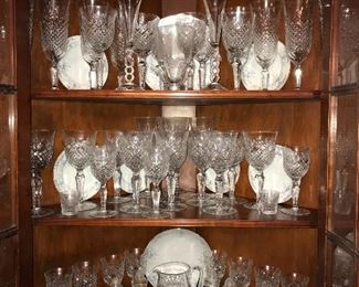 Cabinets packed full of vintage china, crystal, serving pieces, table linens and more. Stemware is American Cut, Brilliant.