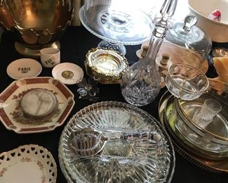 Tables full of decor, glassware, silver plated items, candle holders and more.