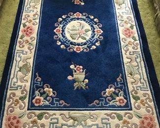 Heavy and plush--wool rug, approximately 5 by 3,