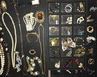 Lots and lots of vintage and con temporary costume jewelry.