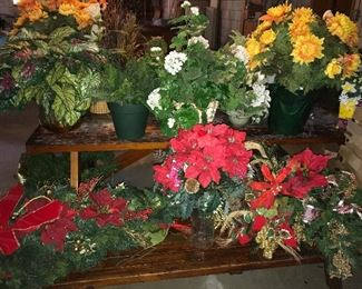 Assorted floral arrangements and wreaths.