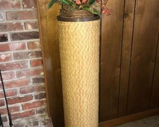 Woven pedestal--shown  with floral arrangement.