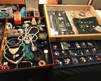Lots and lots of vintage and contemporary costume jewelry and some gold and silver pieces.