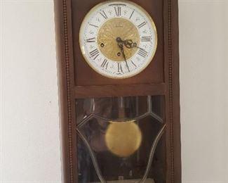 Vintage west German-made wall clock; keeps time