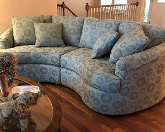 One of two matching circular couches/sofas.