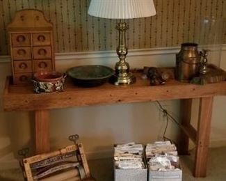 sofa table with wood spice tack, copper items, a washer wringer and dress patterns. love the clock.