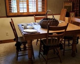 square dining table with 2 additional leaves. the 6 chairs match and include chair pads.