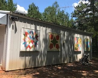 Large outer building/Apartment, on slab included in property.  Painted panels are cool idea for decor .  But will not be available for purchase during the sale.