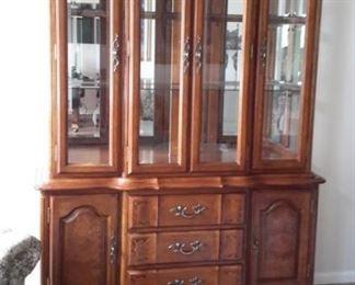 Beautiful lighted china cabinet.