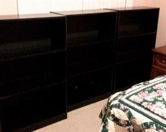 Three matching bookshelves.