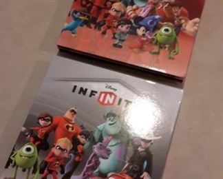 Disney Infinity character game pieces, in boxes.