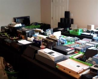 Everything from routers, switches, hubs, chargers, monitoring kits, webcams, headsets, game controllers, docks, keyboards, monitors, laptops, Apple products to stereo cabinets, shelves, tv stands, printers, books, music and MORE!!