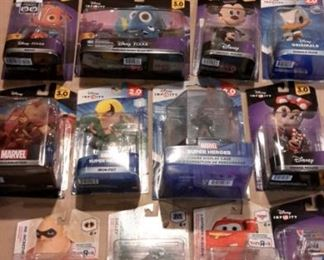 Disney Infinity figures and power packs, new in box.