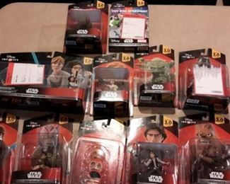 Disney Infinity Star Wars figures and power packs, new in box.
