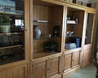 Wall unit - 4 sections - able to sell separately - 2 glass front sections with wood shelves and 2 sections with open glass shelves.   All sections have lower cabinet fronts doors