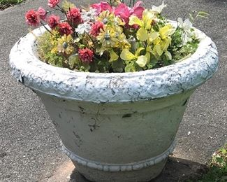 One of several matching large concrete pots