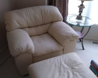 White leather overstuffed chair with matching ottoman