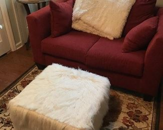 Fun furry ottoman, red loveseat.