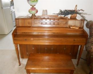This piano is gorgeous!  Solid wood, mid-century detailing.